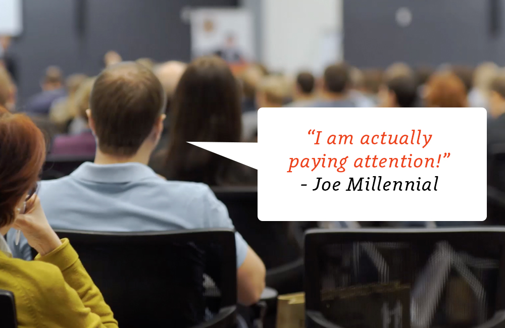 """Person in an audience with caption """"I am actually paying attention!"""""""
