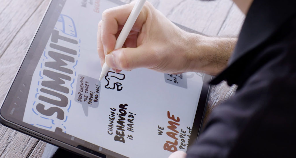 Live sketch artist using graphic facilitation tool on ipad