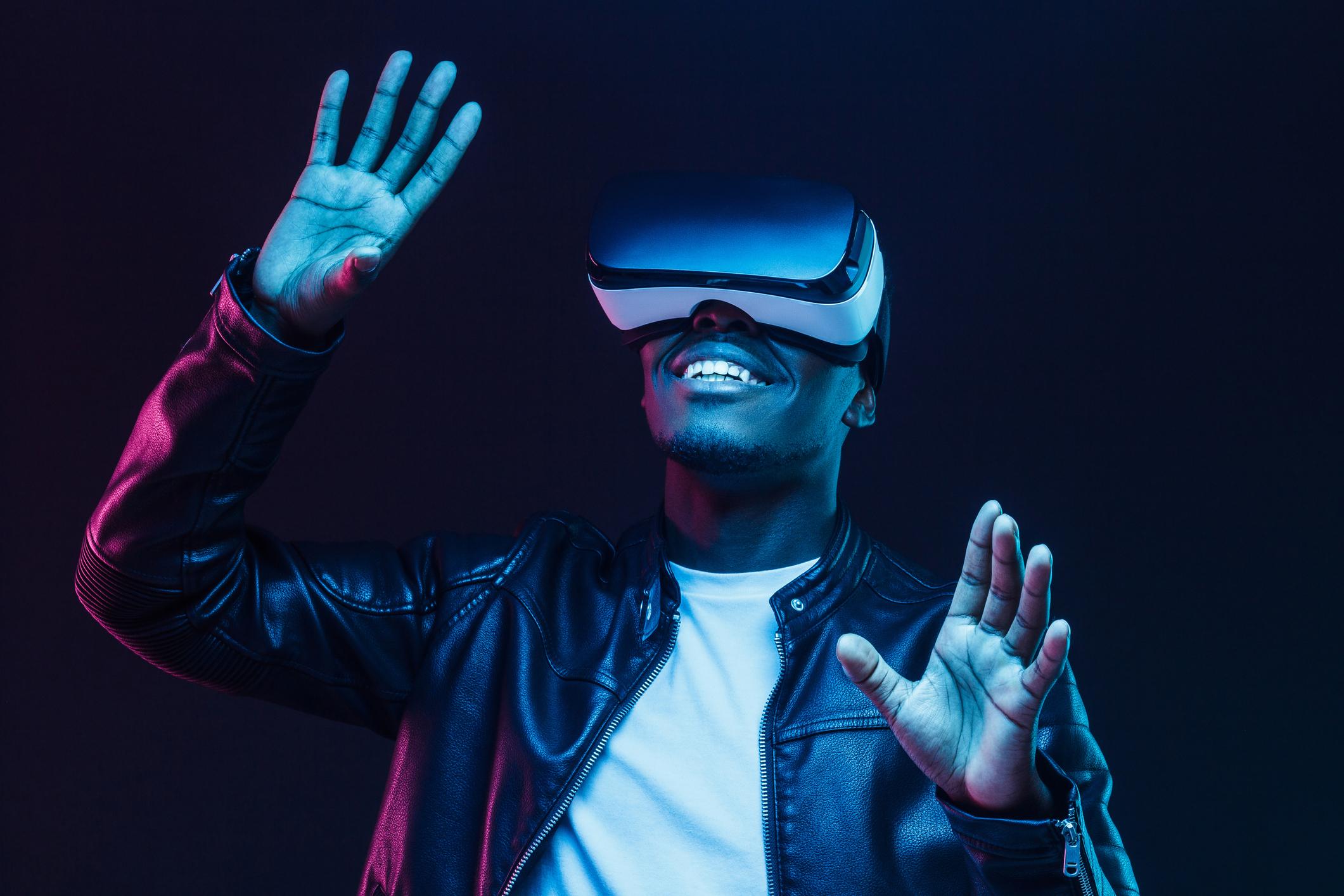 Young man using virtual reality goggles at a tradeshow